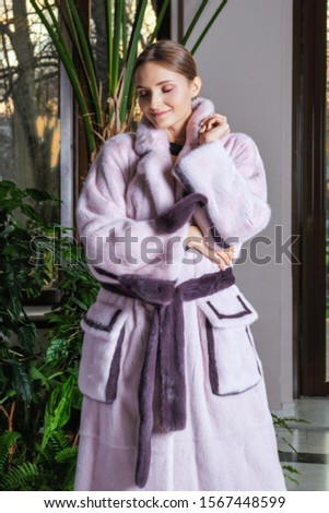 Beautiful fashion model posing in fur coat #1567448599