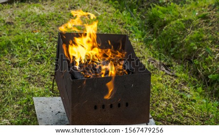 Empty Barbecue Flaming Charcoal Grill With Bright Flames Of Fire #1567479256