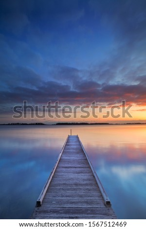 A small jetty on a lake at sunrise. Photographed near Amsterdam in The Netherlands. #1567512469