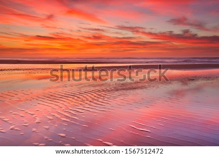 Beautiful sunset and reflections on the beach at low tide. #1567512472