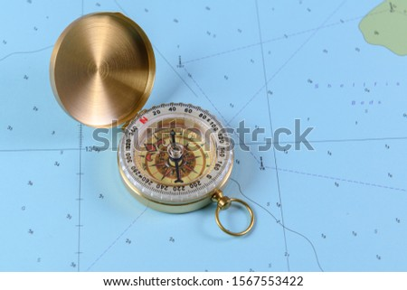 Magnetic compass on a nautical navigational map #1567553422