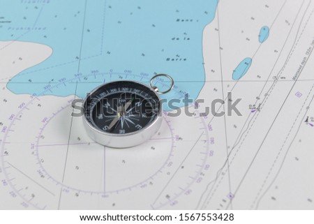 Magnetic compass on a nautical navigational map #1567553428