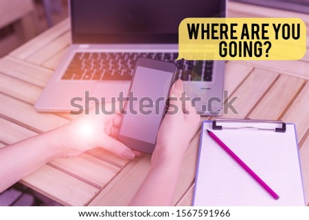 Handwriting text Where Are You Goingquestion. Concept meaning used to ask someone the destination headed to woman laptop computer smartphone office supplies technological devices. #1567591966