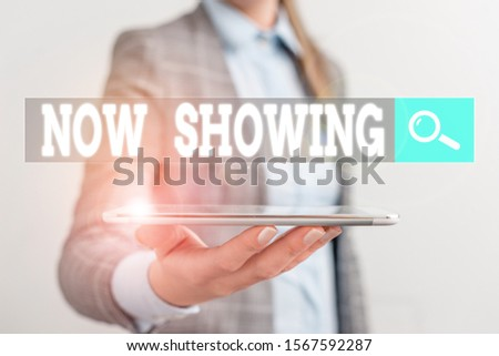 Writing note showing Now Showing. Business photo showcasing opportunity for the public to see something currently available Business concept with mobile phone and business woman. #1567592287