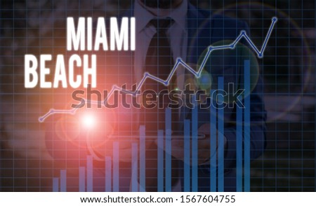 Handwriting text Miami Beach. Concept meaning the coastal resort city in MiamiDade County of Florida. #1567604755
