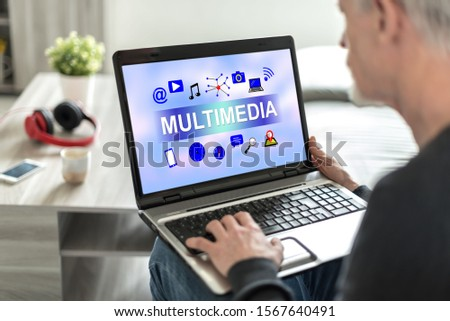 Laptop screen displaying a multimedia concept #1567640491