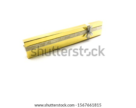 Golden gift box isolated on a white background. Yellow gift wrap for jewelry. Packaging for jewelry. Packaging with a bow. Packaging for a necklace. #1567661815