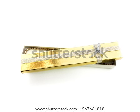 Golden gift box isolated on a white background. Yellow gift wrap for jewelry. Packaging for jewelry. Packaging with a bow. Packaging for a necklace. #1567661818