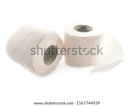 Toilet paper isolated on a white background. The composition of the rolls of toilet paper. Toilet paper with a pattern. Set of toilet paper. #1567744939