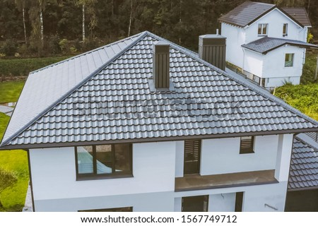 Modern roof made of metal. Corrugated metal roof and metal roofing. #1567749712
