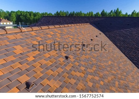 Roof tiles, roof on the roof of the house. roof tile #1567752574