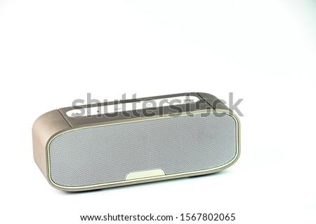 Metall wireless speaker in white background. Royalty-Free Stock Photo #1567802065
