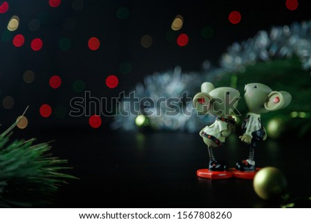 A couple of mice toy, symbol of Chinese happy new 2020 on dark background table and new year pine. New Year 's 2020 Symbol. Christmas rat or mouse concept. Top view. Place for text.