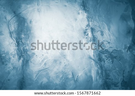 Ice texture background. Textured frosty surface of ice blocks. #1567871662