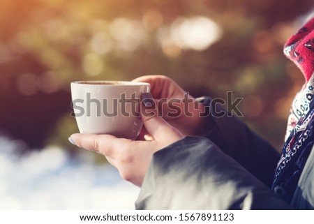 Woman hands holding a cup of coffee outside cafe terrace. Coffee break time. People, lifestyle and mood. Female toasting cappuccino. Morning time with coffee #1567891123