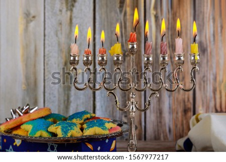 Jewish holiday, Holiday symbol Hanukkah Brightly Glowing Hanukkah Menorah soft focus #1567977217