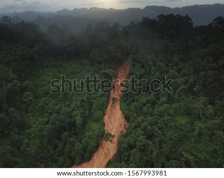Heavy rain, and erosion caused of the landslide large masses of earth slip along slope of hill. #1567993981