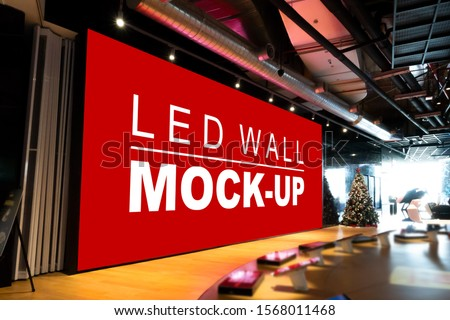 Mock up perspective blank large LED wall on stage in big bike showroom with clipping path, empty space for insert advertising, multi-media for information and promotion event in shopping mall