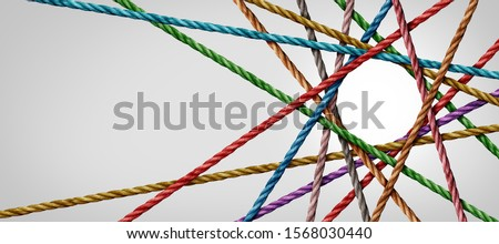 Connected diversity and circle shaped group of ropes creating a centralized circular shape in a horizontal composition as a connect concept for business or social media. Royalty-Free Stock Photo #1568030440