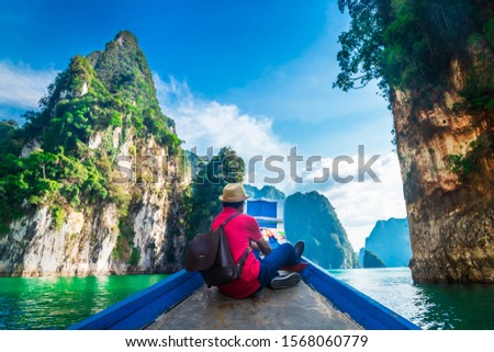 Man traveler on boat joy looking nature rock mountain island scenic landscape Khao Sok National park, Beautiful famous travel adventure place Thailand, Tourism destinations Asia holidays vacation trip #1568060779