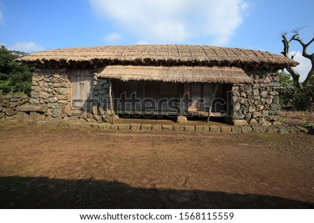 Jeju Island traditional thatched house - Korea Royalty-Free Stock Photo #1568115559