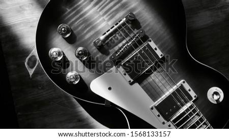 vintage guitar closeup . black and white                              #1568133157