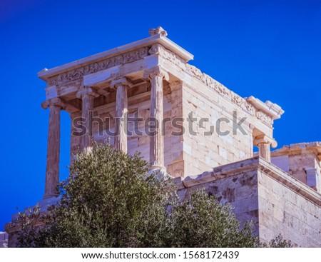 Athena Nike ancient Greeek temple on Acropolis hill, Athens Greece #1568172439