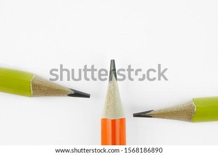 closeup three yellow pencils on white background. Royalty-Free Stock Photo #1568186890