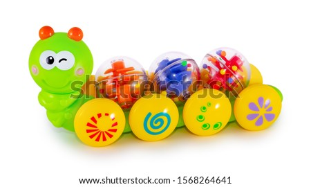 Cute colorful caterpillar toy on wheels with rattle balls isolated on white background with shadow reflection - clipping path. Plastic worm on white backdrop. Rainbow colored plaything for children. #1568264641