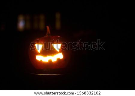 halloween pumpkin on drakness background. #1568332102