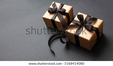Black Friday sale concept. Gift boxes with black ribbon isolated against black background, high angle view #1568414080