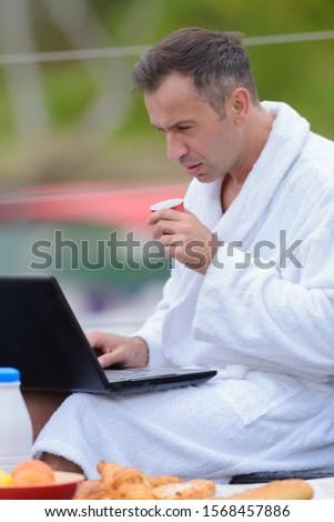 rich man browsing the laptop #1568457886