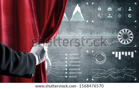 Hand opening red curtain and drawing business graphs and diagrams behind it #1568476570