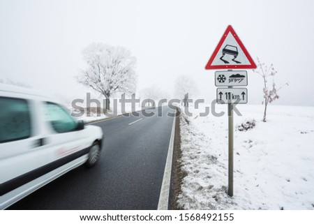 Fast moving van with snowy road