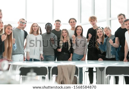 group of diverse young people standing together #1568584870