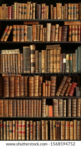 antique books on bookshelf in a library #1568594752