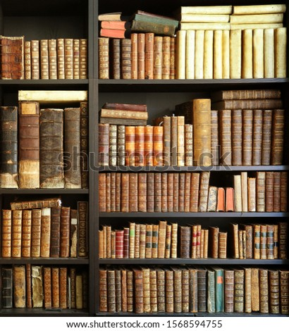 antique books on bookshelf in a library #1568594755