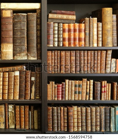 antique books on bookshelf in a library #1568594758