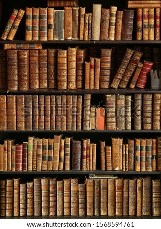 antique books on bookshelf in a library #1568594761