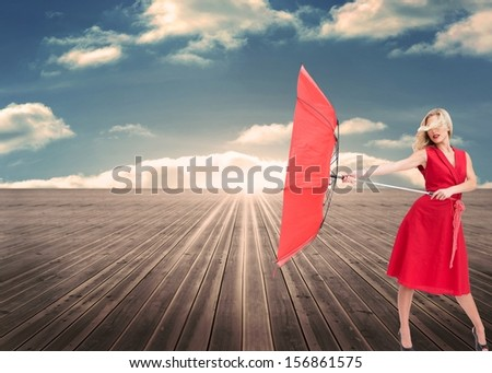Composite image of attractive glamour woman holding a broken umbrella standing on floorboards ending in the sky #156861575