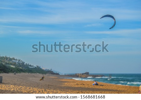 Kite or parchute surfer doing adrenalin rush in Salt rock main beach in Dolphin coast ballito South Africa #1568681668