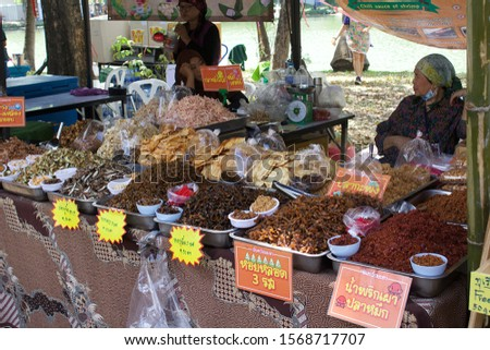 Bangkok, Thailand. November 23, 2019. Annual Fair of the Red Cross in Lumpini Park. Some people enjoy visiting meanwhile other sell their products in the market #1568717707