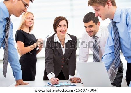 A business team of four plan work in office #156877304