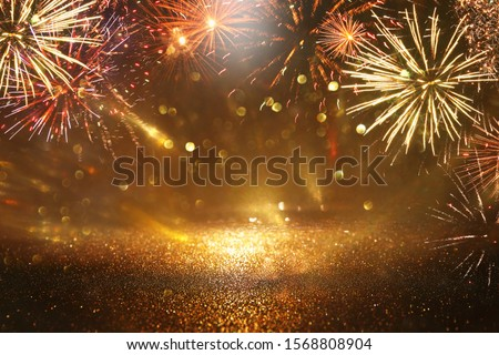 abstract black and gold glitter background with fireworks. christmas eve, 4th of july holiday concept #1568808904