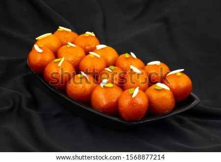 Indian Popular Dessert Gulab Jamun Also know as kala Jamun or Kalajam is a Soft Delicious Berry Sized Balls Made of Milk Solids #1568877214