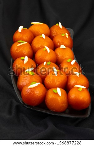 Indian Popular Dessert Gulab Jamun Also know as kala Jamun or Kalajam is a Soft Delicious Berry Sized Balls Made of Milk Solids #1568877226
