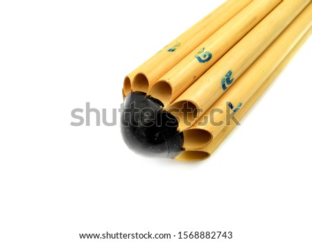 Musical instruments made from bamboo, placed on a white background, handcrafted from Thai folk wisdom, used for instrumental blowing. #1568882743
