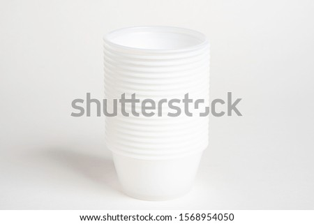 A stack of small plastic container for specimen medical laboratory testing set on a white background. #1568954050