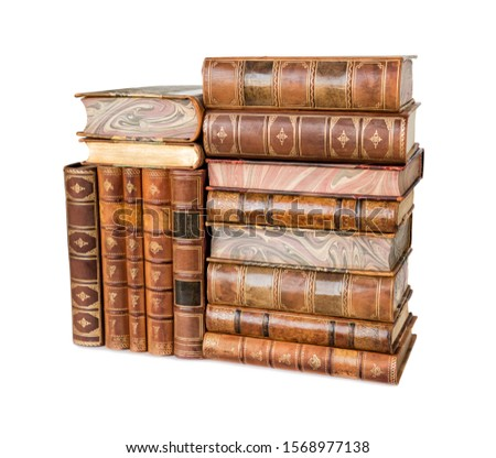 Big heap of antique books in a leather hardcover isolated on a white background #1568977138