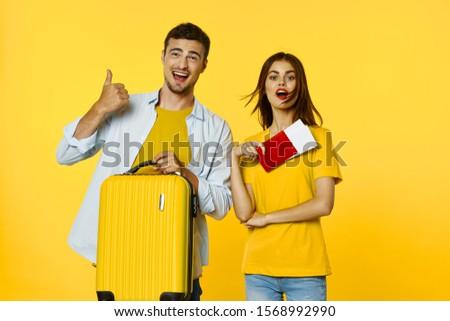 Man travel woman passport tickets suitcase #1568992990